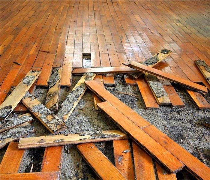 Wooden floor damaged by water